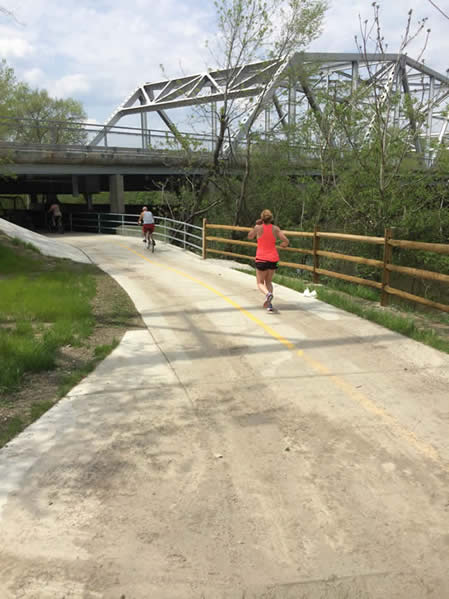 Woman runs on bridge at Lake Katherine